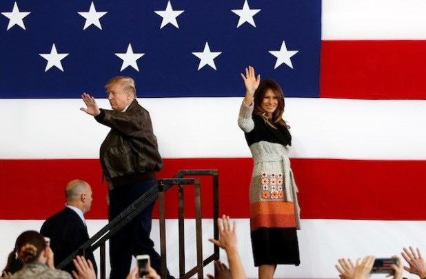 U.S. President Donald Trump and first lady Melania Trump wave on stage at U.S. Air Force Yokota Air Base in Fussa, on the outskirts of Tokyo, Japan, November 5, 2017. REUTERS/Toru Hanai - RC14299080F0