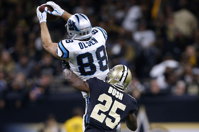 NEW ORLEANS, LA - JANUARY 07: Greg Olsen #88 of the Carolina Panthers catches the ball as Rafael Bush #25 of the New Orleans Saints defends during the second half of the NFC Wild Card playoff game at the Mercedes-Benz Superdome on January 7, 2018 in New Orleans, Louisiana. (Photo by Jonathan Bachman/Getty Images)