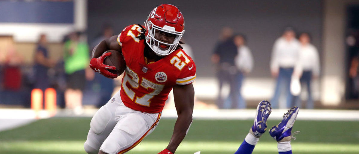 ARLINGTON, TX - NOVEMBER 05:  Kareem Hunt #27 of the Kansas City Chiefs gains first down yardage against Sean Lee #50 of the Dallas Cowboys in the second quarter of a football game at AT&T Stadium on November 5, 2017 in Arlington, Texas.  (Photo by Ron Jenkins/Getty Images)