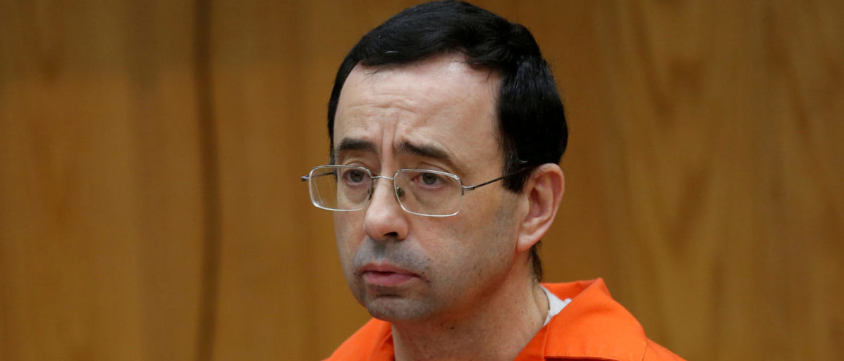 FILE PHOTO: Larry Nassar, a former team USA Gymnastics doctor who pleaded guilty in November 2017 to sexual assault, listens to victims impact statements during his sentencing in the Eaton County Circuit Court in Charlotte, Michigan, U.S., January 31, 2018.   REUTERS/Rebecca Cook/File Photo