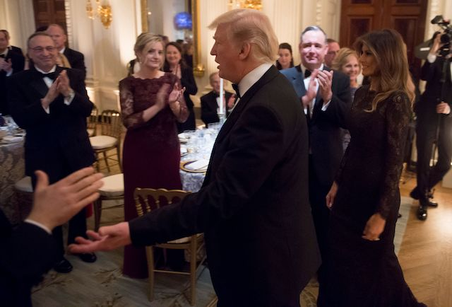 US President Donald Trump and First Lady Melania Trump arrive for the Governors Ball for US governors attending the National Governors Association (NGA) winter meeting in the State Dining Room of the White House in Washington, DC, February 25, 2018. / AFP PHOTO / SAUL LOEB (Photo credit should read SAUL LOEB/AFP/Getty Images)
