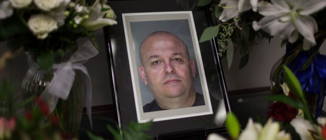 A memorial for Sacramento County Sheriff's Deputy Danny Oliver sits in the Sheriff's Department in Sacramento, October 28, 2014. A couple accused of a bloody Northern California shooting spree that killed two sheriff's deputies, wounded a third and left a motorist fighting for his life were charged Tuesday with murder, attempted murder and carjacking, authorities said. Marcelo Marquez, known to federal authorities as Luis Enrique Monroy-Bracamonte, and Janelle Marquez Monroy terrorized communities on the eastern edge of Sacramento Oct. 24, starting with the shooting of Sacramento Sheriff's Deputy Danny Oliver in the parking lot of a motel. Marquez, 34, was charged with two counts of murder with special circumstances, which can bring the death penalty, along with one count of attempted murder and several counts of carjacking, according to a criminal complaint released by Sacramento County District Attorney Rod Norgaard. REUTERS/Max Whittaker