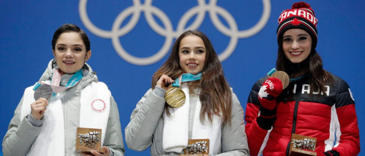 Medals Ceremony - Figure Skating - Pyeongchang 2018 Winter Olympics - Women Single Skating free skating  - Medals Plaza - Pyeongchang, South Korea - February 23, 2018 - Gold medalist Alina Zagitova, an Olympic Athlete from Russia, silver medalist Evgenia Medvedeva, an Olympic Athlete from Russia, and bronze medalist Kaetlyn Osmond of Canada on the podium. REUTERS/Eric Gaillard