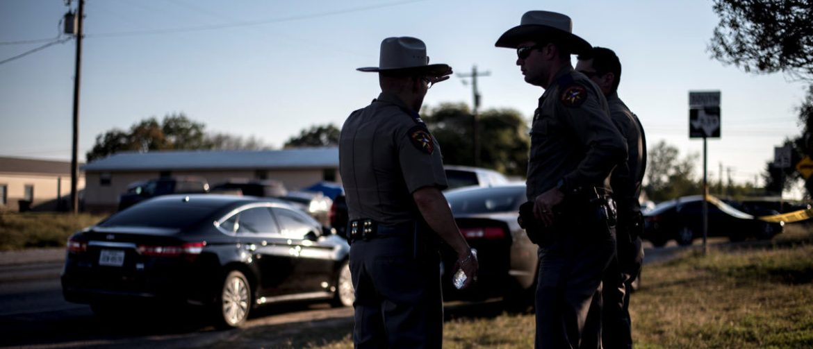 Members of the Wilson County Sheriff's office stand just inside taped off area near the First Baptist Church where a shooting left many dead and injured in Sutherland Springs, Texas, U.S., November 5, 2017.   REUTERS/Sergio Flores