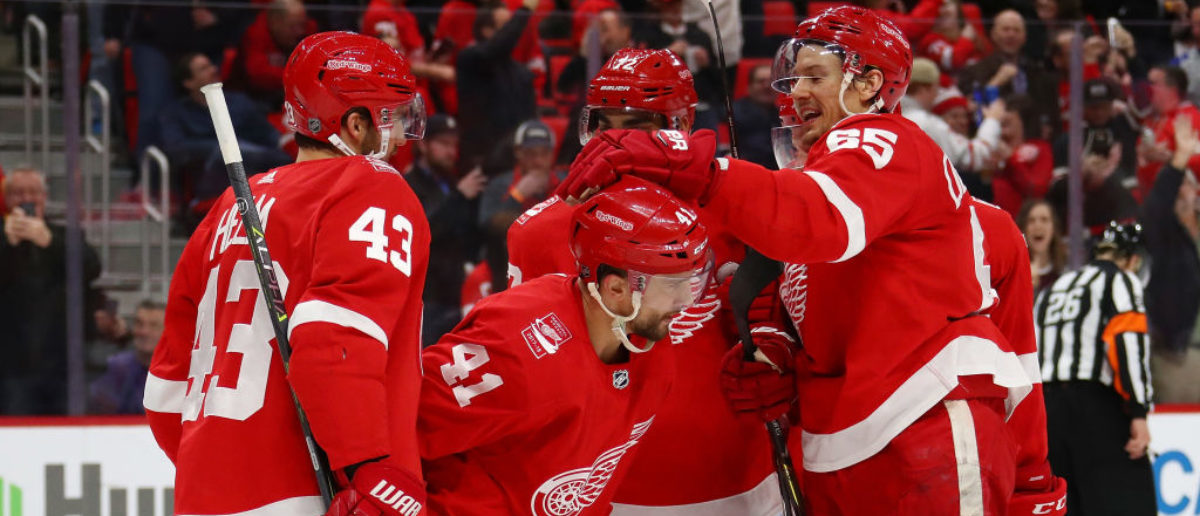 DETROIT, MI - MARCH 27: Luke Glendening #41 of the Detroit Red Wings celebrates his second period goal with teammates while playing the Pittsburgh Penguins at Little Caesars Arena on March 27, 2018 in Detroit, Michigan. (Photo by Gregory Shamus/Getty Images)