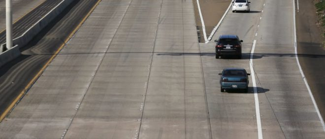 The lack of painted freeway lane markers is seen on Interstate highway 5 in San Diego, California February 10, 2016. Picture taken February 10. To match Insight AUTOS-AUTONOMOUS/INFRASTRUCTURE     REUTERS/Mike Blake | Immigrants Injured In Car Crash