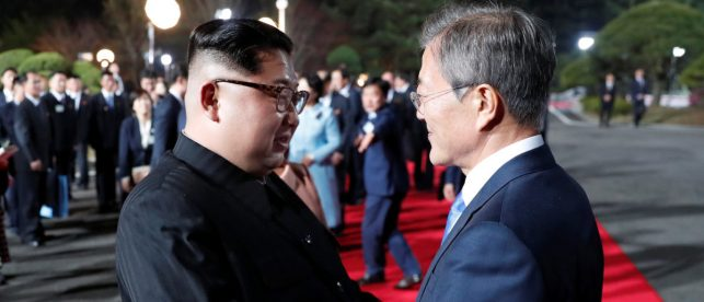 South Korean President Moon Jae-in shakes hands with North Korean leader Kim Jong Un as Kim leaves after a farewell ceremony at the truce village of Panmunjom inside the demilitarized zone separating the two Koreas, South Korea, April 27, 2018. Korea Summit Press Pool/Pool via Reuters | NK Media: Kim Is Ready To Denuclearize via Reuters