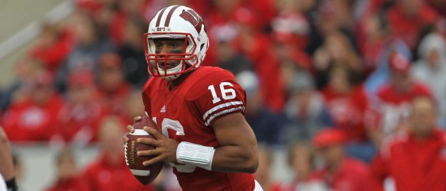 MADISON, WI - SEPTEMBER 24: Russell Wilson #16 of the Wisconsin Badgers looks for a receiver against the South Dakota Coyotes at Camp Randall Stadium on September 24, 2011 in Madison Wisconsin. Wisconsin defeated South Dakota 59-10. (Photo by Jonathan Daniel/Getty Images)