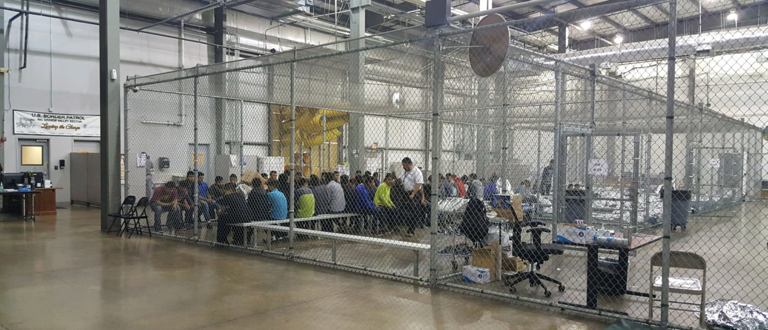 A view of inside U.S. Customs and Border Protection (CBP) detention facility shows detainees inside fenced areas at Rio Grande Valley Centralized Processing Center in Rio Grande City, Texas, U.S., June 17, 2018. Picture taken on June 17, 2018. Courtesy CBP/Handout via