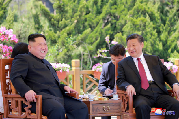 North Korean leader Kim Jong Un meets with China's President Xi Jinping, in Dalian, China in this undated photo released on May 9, 2018 by North Korea's Korean Central News Agency (KCNA). KCNA/via REUTERS