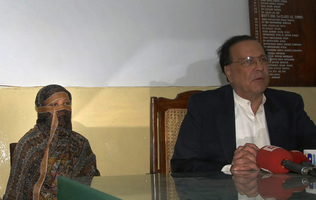 Asia Bibi, a Pakistani Christian woman who has been sentenced to death for blasphemy, sits next to Governor of the Punjab Province Salman Taseer as he talks to media after visiting her inside the central jail in Sheikhupura, located in Pakistan's Punjab Province November 20, 2010. Bibi, 36, who was handed down the death sentence by a court in Nankana district in central Punjab earlier this month, appealed President Asif Ali Zardari on Saturday to pardon her, saying she was wrongly implicated in the case. REUTERS/Asad Karim