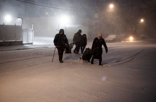 Pedestrians walk through snow and ice in New York on November 15, 2018. - The National Weather Service is predicting snowfall totals of 2 to 4 inches in New York City. (Photo by Don EMMERT / AFP) (Photo credit should read DON EMMERT/AFP/Getty Images)