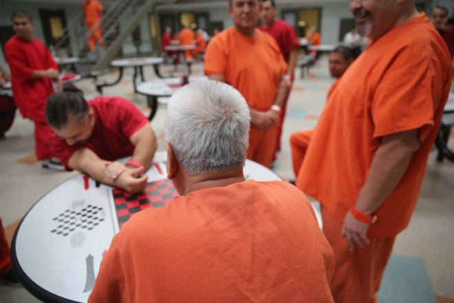 Immigrant detainees talk while in a general population block at the Adelanto Detention Facility on November 15, 2013 in Adelanto, California. John Moore/Getty Images