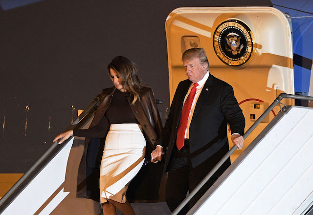 US President Donald Trump (R) and US First Lady Melania Trump, disembark from Air Force One upon arrival at Ezeiza International airport in Buenos Aires province, on November 29, 2018, on the eve of the G20 Leaders' Summit. - US President Donald Trump jets into Argentina on Thursday for a G20 summit, keen to do battle with China on trade and sharpening his rhetoric against Russia over Ukraine.(Photo credit: JUAN MABROMATA/AFP/Getty Images)