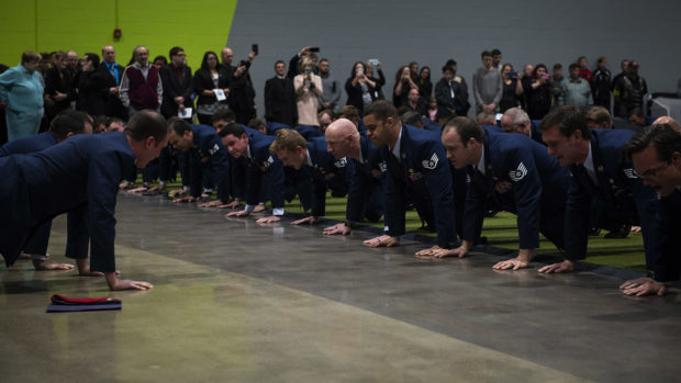 Airmen and family members perform memorial pushups in honor of U.S. Air Force Staff Sgt. Dylan Elchin, a Special Tactics combat controller with the 26th Special Tactics Squadron, during a memorial service in Moon Township, Pennsylvania, Dec. 6, 2018. Elchin was killed alongside two U.S. Army Special Forces members when their vehicle struck an improvised explosive device in Ghazni Province, Afghanistan, Nov. 27. (U.S. Air Force photo by Senior Airman Joseph Pick)