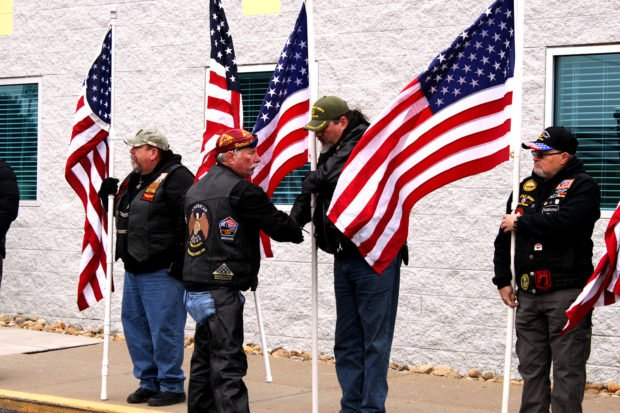 Patriot Guard Riders ride captain Randy Ruff (maroon bandana) shakes the hand of a fellow rider as they line up at the entrance to the Impact Christian Church in Moon Township, Pennsylvania on Dec. 6, 2018. (Will Racke/TheDCNF)