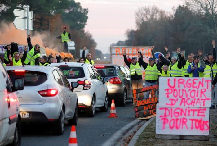 Protesters wearing yellow vests, the symbol of a French drivers' protest against higher diesel fuel prices, occupy a roundabout in Cissac-Medoc