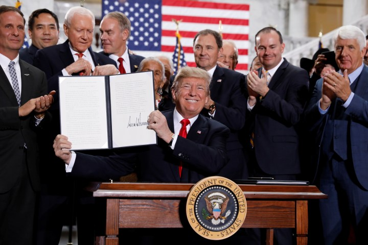 U.S. President Donald Trump smiles after signing a proclamation announcing big cuts to Utah's sprawling wilderness national monuments during an event at the State Capitol in Salt Lake City, Utah, U.S., December 4, 2017. REUTERS/Kevin Lamarque