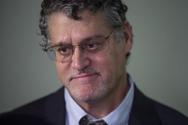 Fusion GPS Co-Founder Glenn Simpson listens as his lawyer, Joshua Levy, speaks to members of the media following a meeting with members of the House Judiciary and Oversight Committee in the Rayburn Office Building on Capitol Hill on October 16, 2018 in Washington, D.C. (Photo by Zach Gibson/Getty Images)