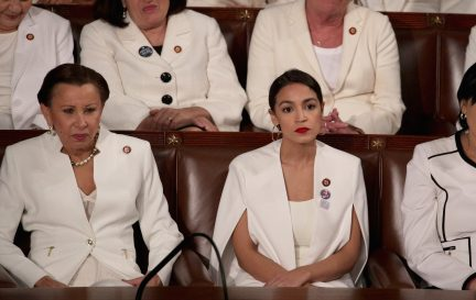 (L to R) Rep. Nydia Velazquez and Rep. Alexandria Ocasio-Cortez watch President Donald Trump's State of the Union address in the chamber of the U.S. House of Representatives at the U.S. Capitol Building on February 5, 2019 in Washington, DC. (Photo by Alex Wong/Getty Images)