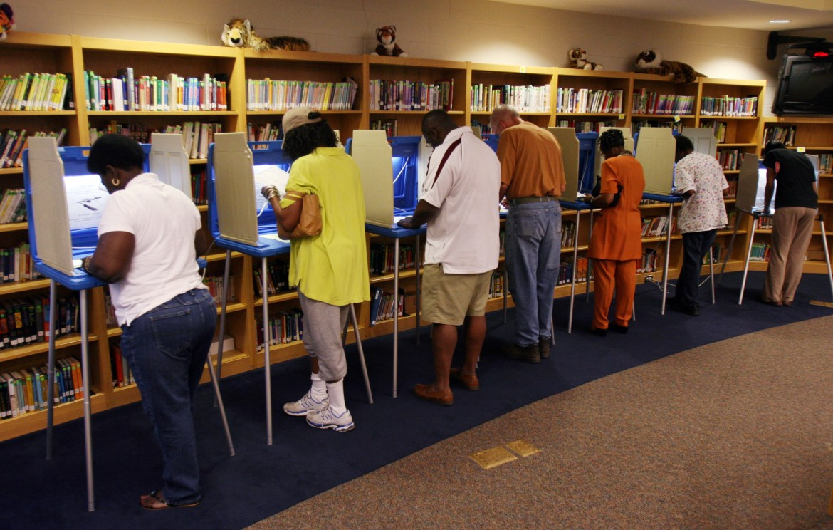WILMINGTON, NC - MAY 6: Voters cast their ballots at the Williston Middle School polling station the morning of May 6, 2008 in Wilmington, North Carolina. Voters in Indiana and North Carolina have their primary polls May 6. (Photo by Logan Mock-Bunting/Getty Images)