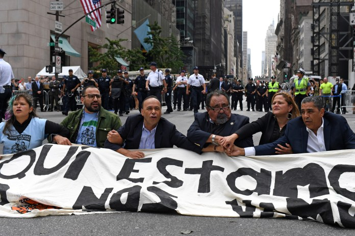 Congressman Espaillat, Speaker of the New York City Council Mark-Viverito, Congressman Grijalva and Congressman Gutierrez sit on 5th Avenue during a rally to demand that President Trump works with Congress to pass a clean DREAM Act in New York
