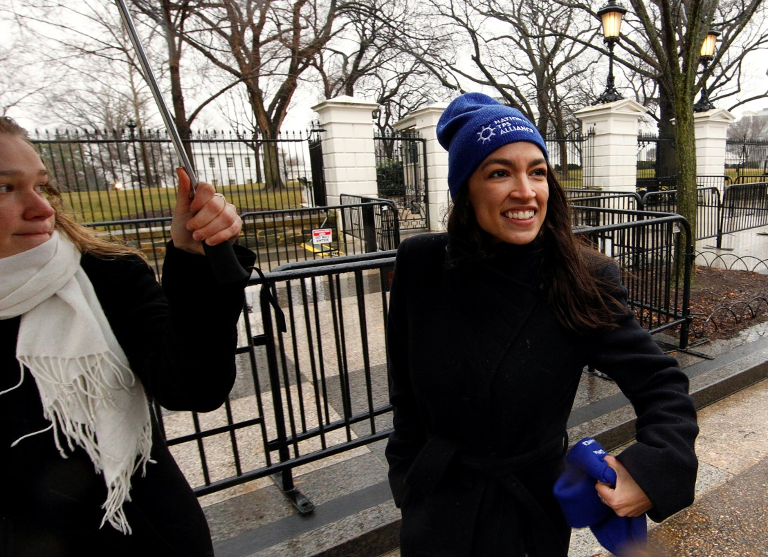 Rep. Alexandria Ocasio-Cortez leaves after addressing immigration rights activists during a rally in front of the White House in Washington