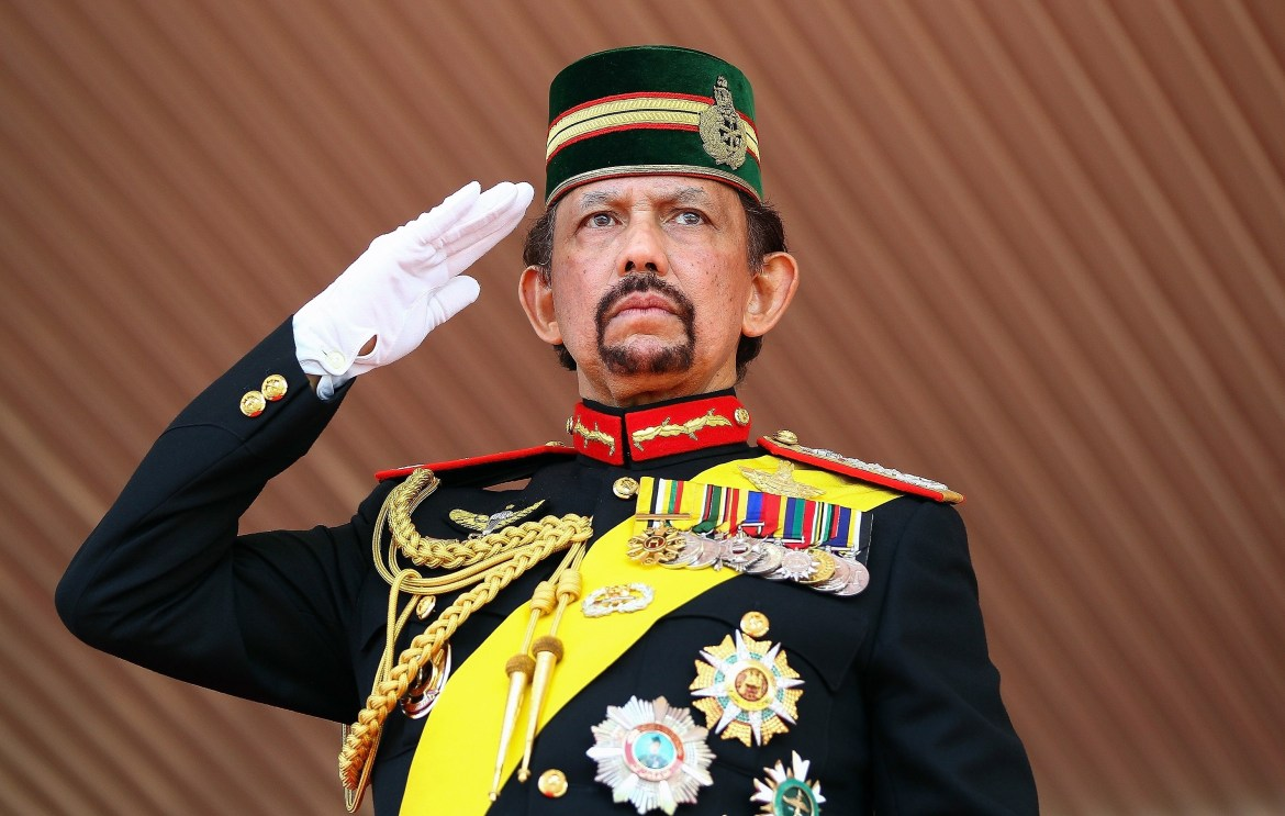 Brunei's Sultan Hassanal Bolkiah salutes during a ceremonial guard of honour to mark his 68th birthday celebrations in Bandar Seri Begawan on August 14, 2014. The monarch turned 68 on July 15, but the celebrations were postponed due to the holy month of Ramadan. The sultan is one of the world's longest-reigning monarchs. AFP PHOTO (Photo credit should read STR/AFP/Getty Images)