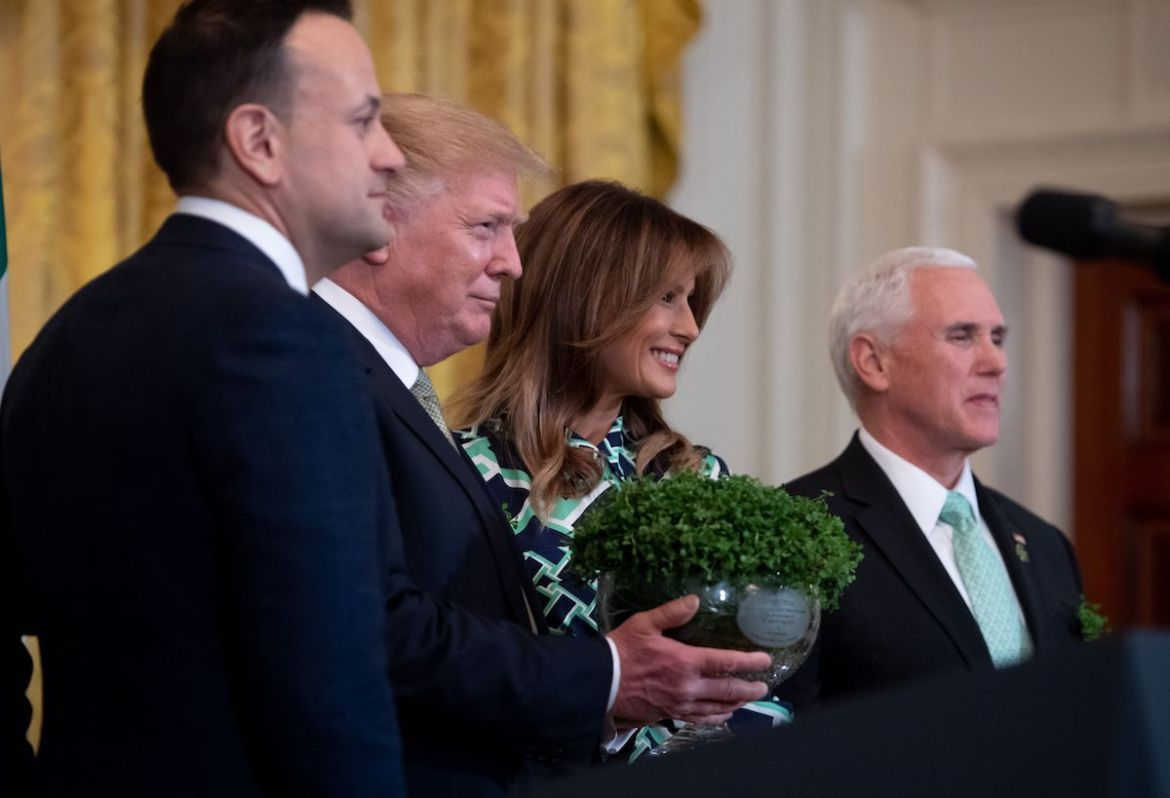 Irish Prime Minister Leo Varadkar (L) presents a bowl of shamrocks to US President Donald Trump alongside US First Lady Melania Trump (2nd R) and US Vice President Mike Pence (R) during a Shamrock Bowl Presentation in honor of St. Patrick's Day in the East Room of the White House in Washington, DC, March 14, 2019. (Photo credit: SAUL LOEB/AFP/Getty Images)