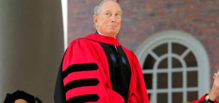 Former New York Mayor Michael Bloomberg stands to receive an honorary Doctor of Laws degree as fellow honorary degree recipients musician Aretha Franklin (L) and former United States President George H.W. Bush (R) applaud during the 363rd Commencement Exercises at Harvard University in Cambridge, Massachusetts, May 29, 2014. REUTERS/Brian Snyder