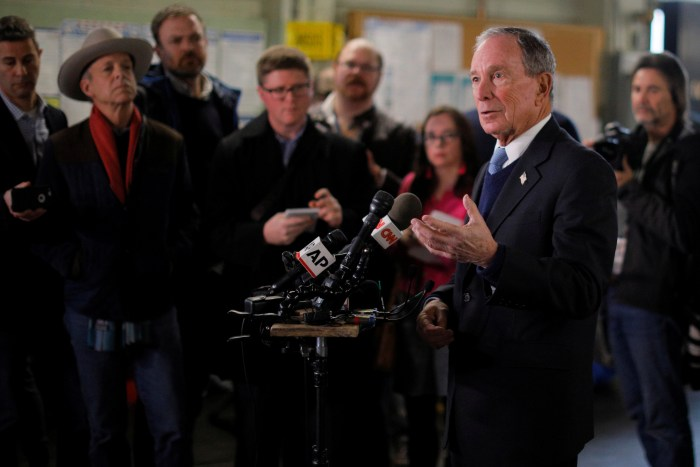Former New York City Mayor Bloomberg answers questions from reporters in Nashua