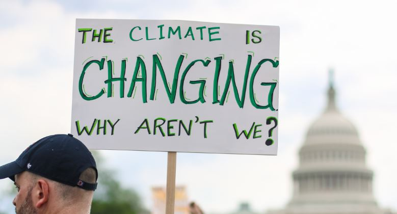 Washington, DC – April 29, 2017: Thousands of people attend the People's Climate March to stand up against climate change. (Nicole S Glass/Shutterstock)