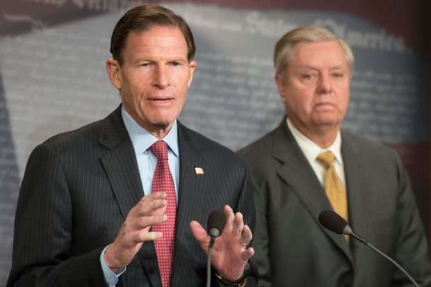 US Senator Lindsey Graham (R), R-South Carolina, and US Senator Richard Blumenthal (L), D-Connecticut, explain Extreme Risk Protection Orders on Capitol Hill in Washington, DC, on March 8, 2018. (JIM WATSON/AFP/Getty Images)