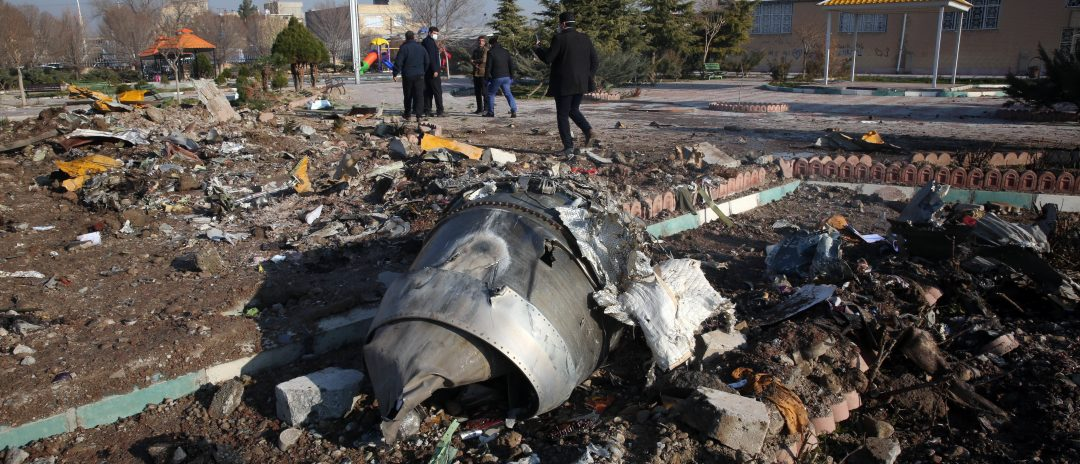Rescue teams work amidst debris after a Ukrainian plane carrying 176 passengers crashed near Imam Khomeini airport in the Iranian capital Tehran early in the morning on January 8, 2020, killing everyone on board. - The Boeing 737 had left Tehran's international airport bound for Kiev, semi-official news agency ISNA said, adding that 10 ambulances were sent to the crash site. (Photo by AFP via Getty Images)