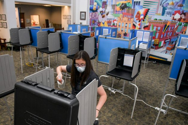 Andrew Romanoff DENVER, CO - JUNE 30: Election judge Miriam Dubinsky sanitizes a voting booth as people vote in the primary election on June 30, 2020 in Denver, Colorado. Voters will decide between former Gov. John Hickenlooper and former Colorado House of Representatives Speaker Andrew Romanoff to face off in the November U.S. Senate race against Sen. Cory Gardner. (Photo by Michael Ciaglo/Getty Images)