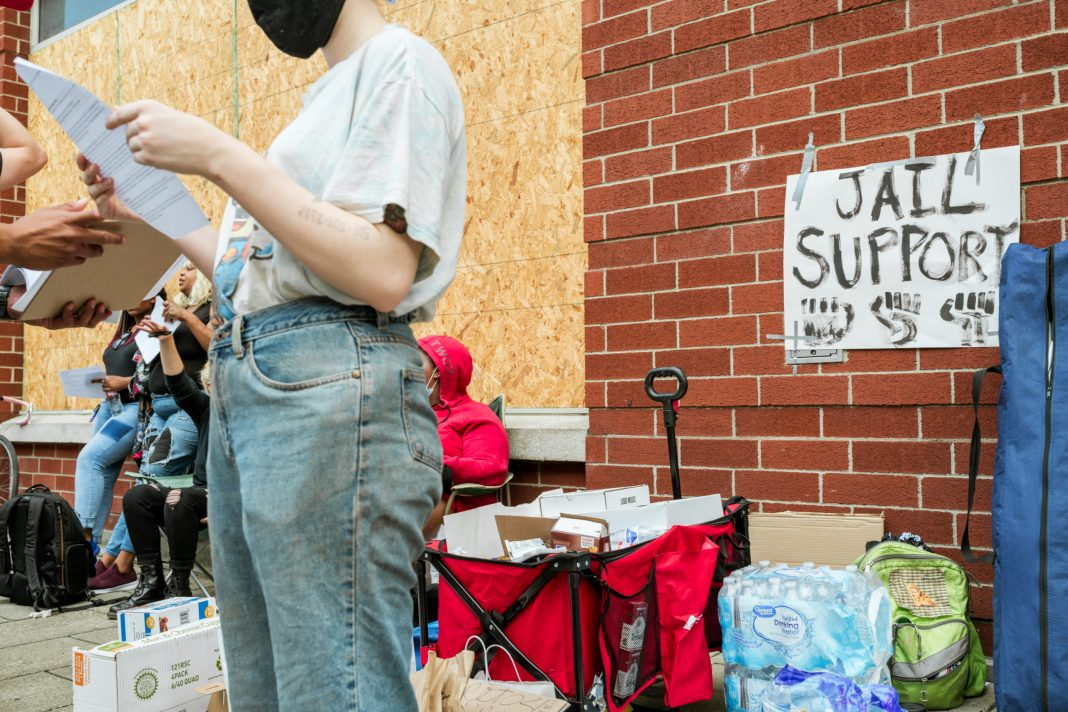 Protesters organize supplies to support demonstrators recently released from jail on September 24, 2020 in Louisville, Kentucky. (Jon Cherry/Getty Images)