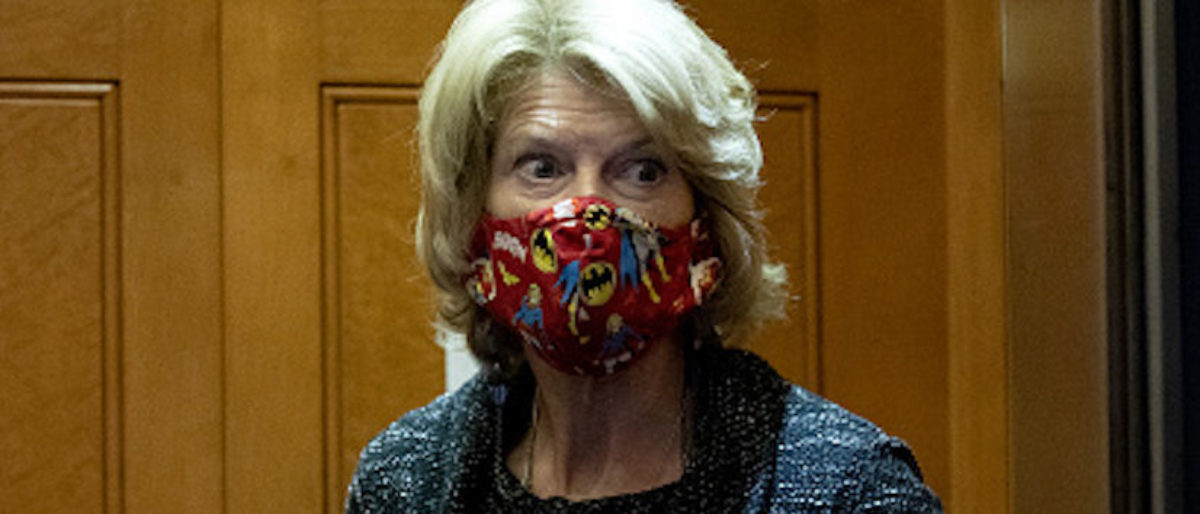 Senator Lisa Murkowski, a Republican from Alaska, wears a protective mask in an elevator at the U.S. Capitol in Washington, D.C., U.S., on Thursday, Dec. 3, 2020. House Speaker Pelosi and Senate Democratic leader Schumer yesterday threw their support behind using a $908 billion bipartisan stimulus proposal as the foundation for a new round of negotiations with congressional Republicans and the White House. Photographer: Stefani Reynolds/Bloomberg via Getty Images