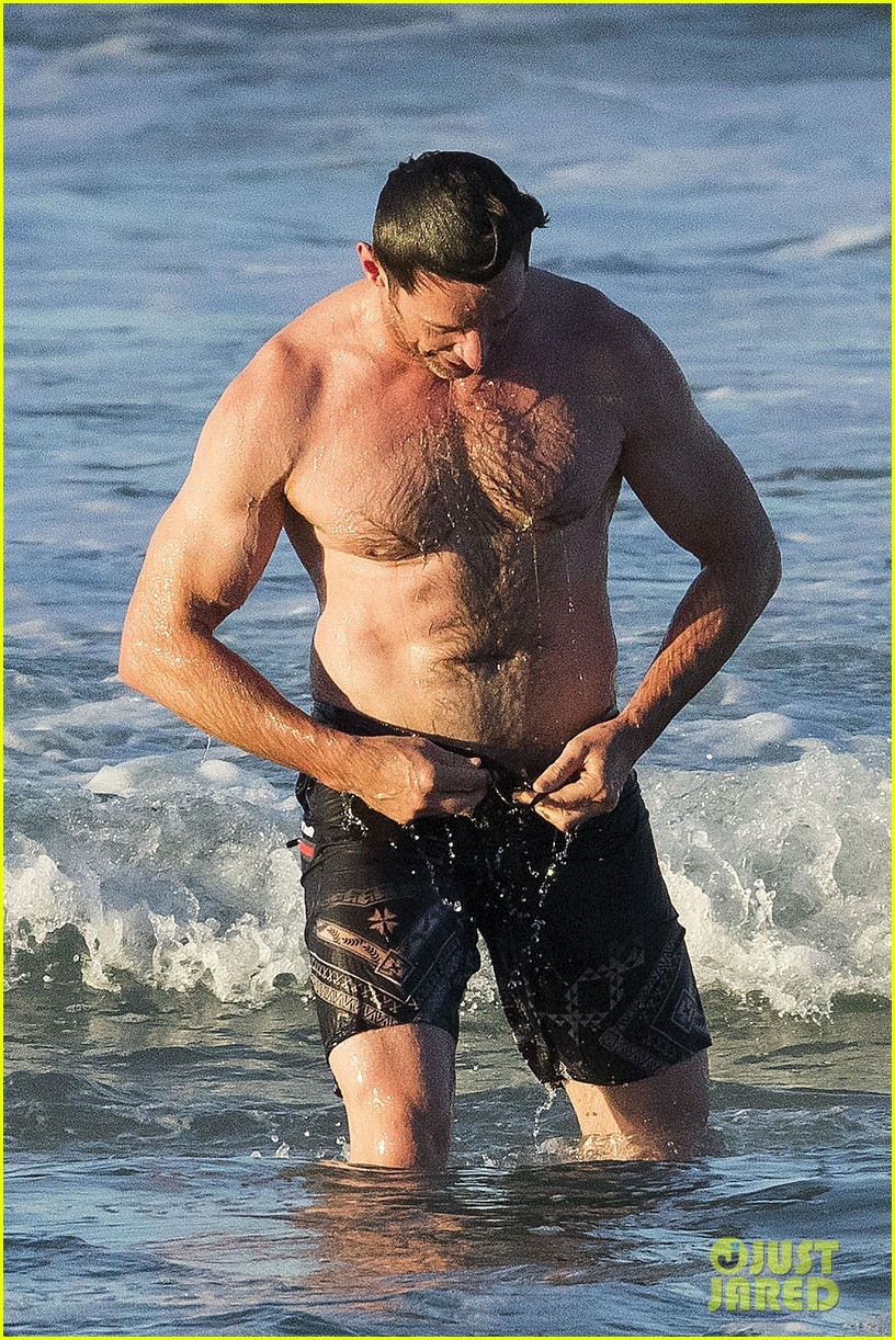 Hugh Jackman Hits The Beach With His Speedo Clad Trainer