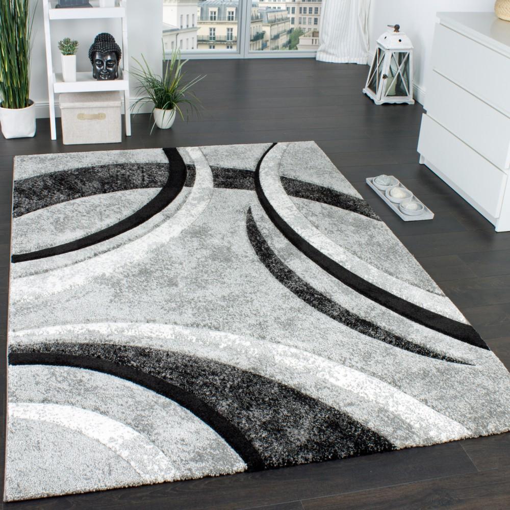 details sur tapis design a contours motif ligne mouchete gris noir creme