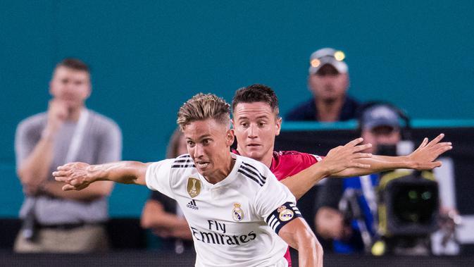 Gelandang Real Madrid, Marcos Llorente (depan) berpotensi hengkang akhir musim ini. (AFP/Rob Foldy)