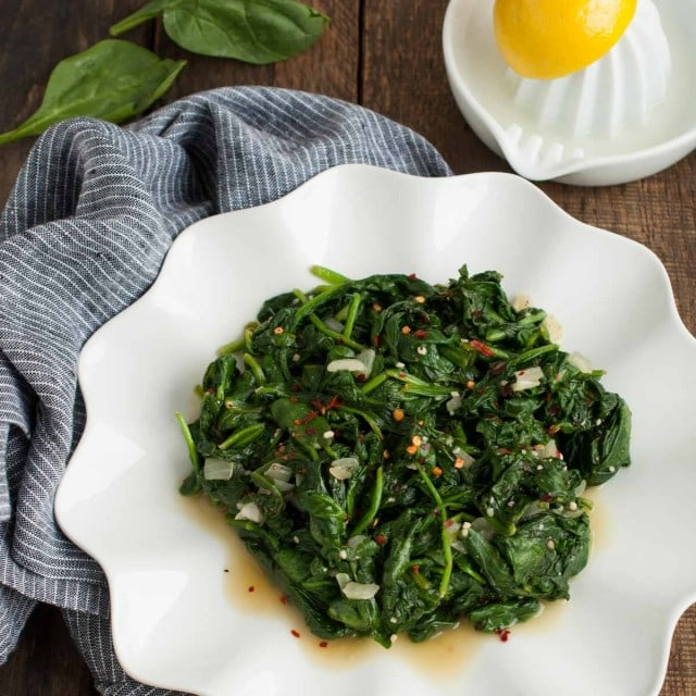 Easy Sauteed Spinach   Feasting not Fasting quick and easy sauteed spinach on a plate