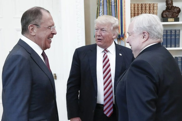 A handout photo made available by the Russian Foreign Ministry shows US President Donald Trump speaking with Russian Foreign Minister Sergei Lavrov (L) and Russian Ambassador to the US Sergei Kislyak during a meeting at the White House. Photo: AFP
