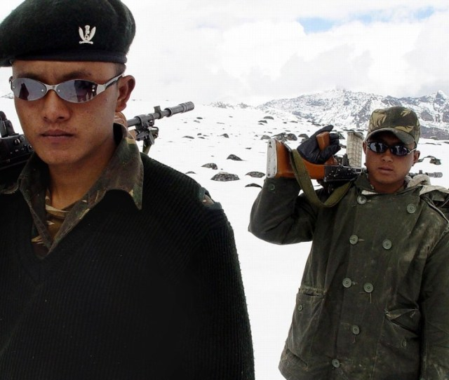 Indian Army Soldiers Of The Gorkha Regiment Patrol The India China Border Photo