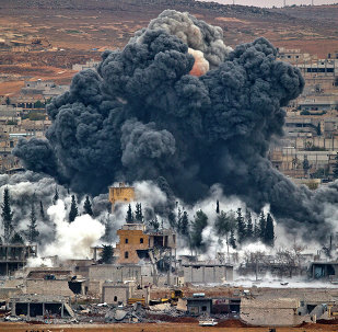 Smoke rises from the Syrian city of Kobani, following an airstrike by the US led coalition