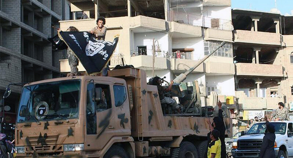Fighters from the al-Qaida linked Islamic State of Iraq and the Levant (ISIL) during a parade in Raqqa, Syria