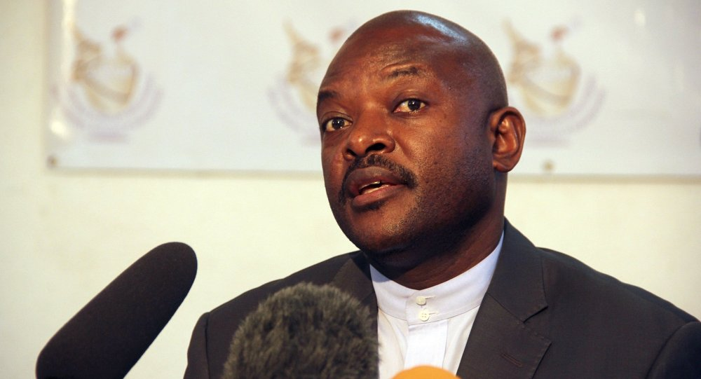 Burundian President Pierre Nkurunziza speaks to the media after he registered to run for a third five-year term in office, in the capital Bujumbura