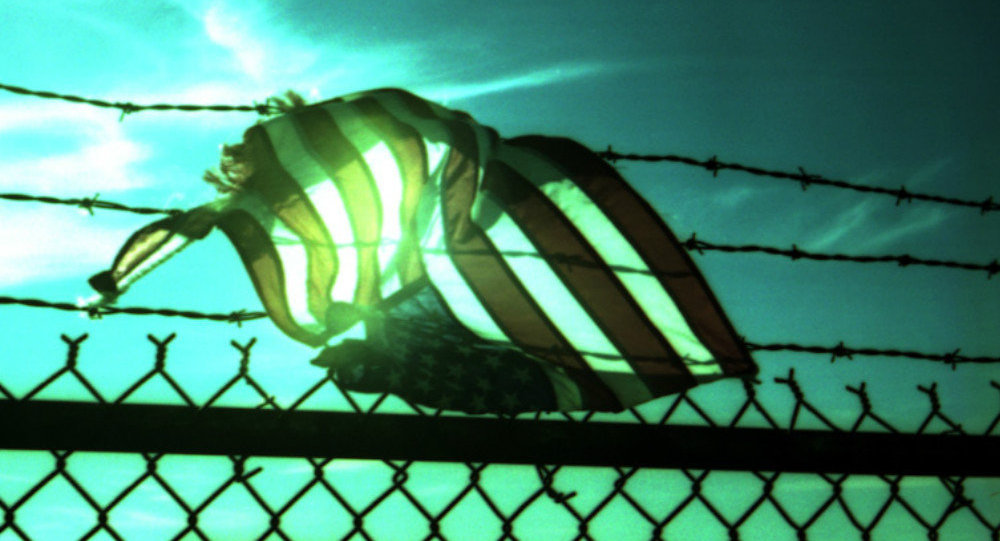 Caught in barbed wire, in the setting sun