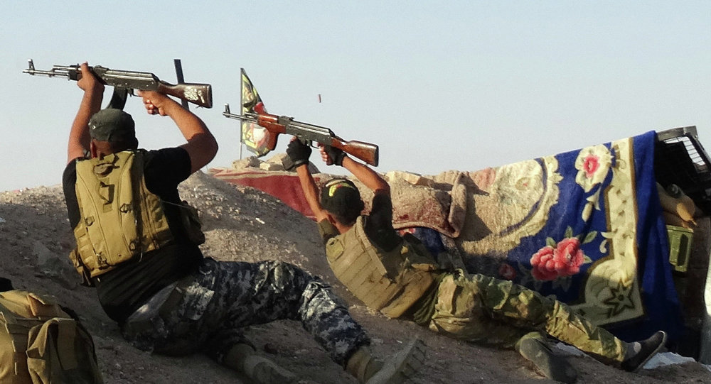 Iraqi security forces defend their positions against Islamic State group attack in Husaybah, 5 miles east of Ramadi, Iraq.