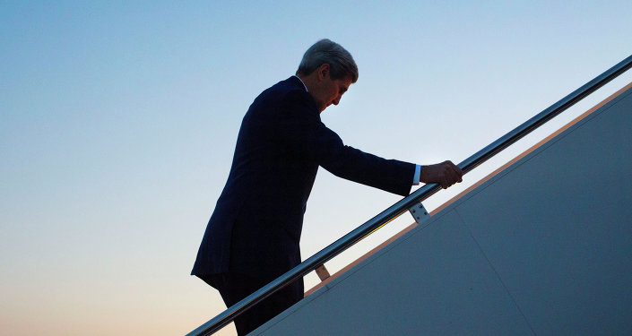 Secretary of State John Kerry walks up the stairs to boards his aircraft at Andrews Air Force Base, Md., August 14, 2015, for a flight to Havana, Cuba