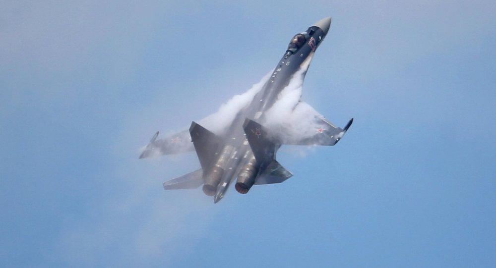 A Sukhoi SU-35 jetfigther performs its demonstration flight during the 50th Paris Air Show at Le Bourget airport, north of Paris, Thursday, June 20, 2013